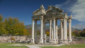 Ancient ruins of famous Tetrapylon Gate in Aphrodisias, Archeological park in Turkey. 4k. Stock Image