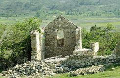 Ancient ruins in the field on the Croatian island of Pag royalty free stock photo