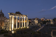 Ancient ruins at forum romanum in Rome at dusk Stock Images