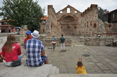 Ancient ruins, group of tourists Stock Photos
