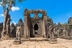 The ancient ruins of a historic Khmer temple in the temple compl Royalty Free Stock Photo