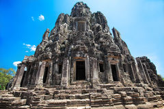 The ancient ruins of a historic Khmer temple in the temple compl Stock Photography