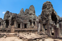 The ancient ruins of a historic Khmer temple in the temple compl Stock Photos