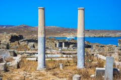 Ancient ruins in the island of Delos in Cyclades, one of the most important mythological, historical and archaeological sites. Ancient ruins in the island of royalty free stock image