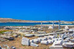 Ancient ruins in the island of Delos in Cyclades, one of the most important mythological, historical and archaeological sites. Ancient ruins in the island of stock photography