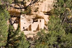 Ancient ruins, Mesa Verde, Colorado. Ancient ruind in Mesa Verde, Colorado, with tourist group Royalty Free Stock Image