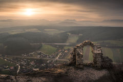Ancient Ruins with Mountains and Village in Background Stock Images