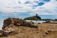 Ancient Ruins of Nora in Sardinia. Ancient Sardinian ruins of Nora, Sardinia, ancient spanish tower of Coltellazzo, Pula, Sardegna, Italy royalty free stock photography