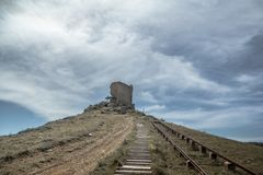 Ancient ruins of the observation tower in Balaklava Bay. royalty free stock image