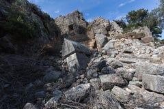 Ancient ruins of Pinara Antic City, Fethiye, Turkey. Ancient ruins in rocky hillside of Pinara Antic City, Fethiye, Turkey Stock Images