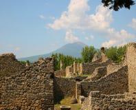 Ancient ruins of Pompei with volcano Vesuvius Stock Photography