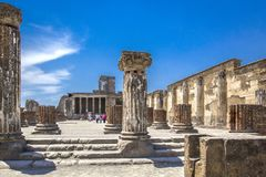 Ancient ruins in Pompeii -Thermopolium of archaeological remains of Via della Abbondanza street, Naples, Italy. royalty free stock photography
