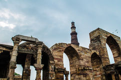 Ancient Ruins and Qutb Minar. Ancient and medieval structures with Qutb Minar, the tallest brick minaret in the world, inspired by the Minaret of Jam in Royalty Free Stock Image