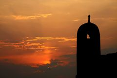 Broad view of sunset near the ruins of ancient mosque tower Royalty Free Stock Photography