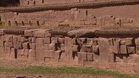 Ancient Ruins Of Tiwanaku, La Paz, Bolivia. Close-up high angle panning shot of ancient walls and stone blocks at Tiwanaku Ruins, La Paz, Bolivia stock video footage