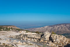 Ancient ruins at Umm Qais with the Sea of Galilee Royalty Free Stock Image