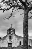 Ancient rural church and cloudy sky. Ancient rural church against a cloudy sky for a black and white image Royalty Free Stock Image