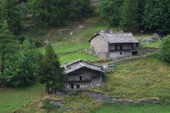 Ancient rural houses in the Alps. Stock Photo