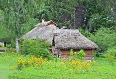 Ancient rural hut and barn. With a straw roof Royalty Free Stock Photo