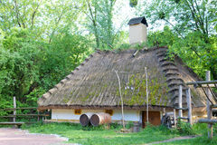 Ancient rural tavern with wooden barrels Royalty Free Stock Images