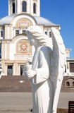 Ancient Russian Abby. Angel statue against ancient Russian Cathedral in Diveevo city Royalty Free Stock Photo