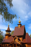 Ancient Russian church. Of wooden logs in traditional style Stock Photos