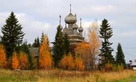 Ancient Russian Church in the autumn forest Stock Photography