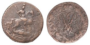 Ancient Russian coin. Depicting the silhouette of St. George the Victorious, the Holy Great Martyr with a denomination of 2 penny isolated on a white background stock photos