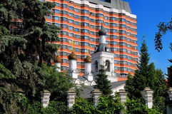 Ancient Russian Orthodox Church against of modern building Royalty Free Stock Photo