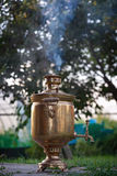 Ancient Russian samovar. A device for making tea. Royalty Free Stock Photo
