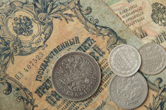 The ancient Russian, silver coins and old banknotes times of Nicolay2 Royalty Free Stock Image