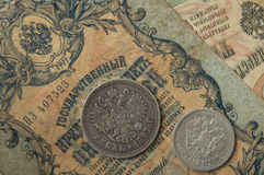 The ancient Russian, silver coins and old banknotes times of  Nicolay 2 Royalty Free Stock Photo