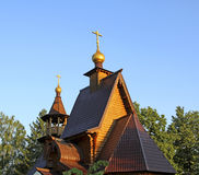 Ancient russian wooden church. Orthodox wooden church on a sunny day Stock Photos