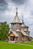 Ancient Russian wooden church under stormy sky. 