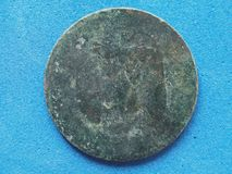 Ancient rusted coin. Ancient rusted weathered coin found underwater in the sea royalty free stock image