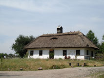 Ancient rustic shack on a field Stock Images