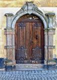Ancient rustic wooden door. Stock Image