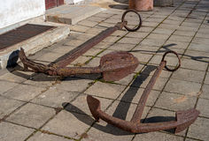 Ancient rusty anchors raised from the bottom of the Baltic Sea. Stock Image
