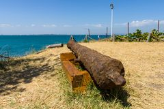 An ancient rusty cannon. Aimed at the side of the sea royalty free stock images