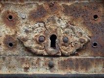 Ancient rusty keyhole. Closed door royalty free stock photo