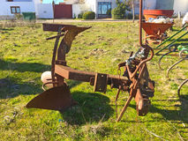 Ancient rusty plow on a village Stock Images