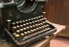 Ancient rusty typewriter used by typists than once Stock Photo