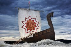 Ancient sailing ship in the severe sea. Ancient wooden sailboat bravely defies the elements Stock Photography