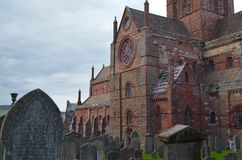 Ancient Saint Magnus cathedral in Kirkwall, Orkney archipelago, Scotland. St. Magnus Cathedral dominates the skyline of Kirkwall, the main town of Orkney, a Royalty Free Stock Photo
