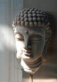 Ancient sand stone Buddha face Stock Photos