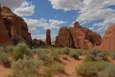 Ancient Sandstone. Arches National Park, clouds puff across landscape of red sandstone remnants of ancient sea beds Royalty Free Stock Photos