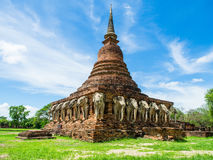 An ancient sandstone pagoda with Elephant Sculptures at the base of Pagoda in Sorarak Temple Royalty Free Stock Image