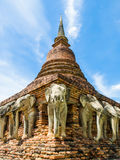An ancient sandstone pagoda with Elephant Sculptures at the base of Pagoda in Sorarak Temple Royalty Free Stock Photo