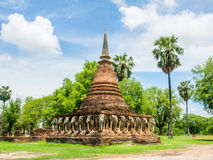 An ancient sandstone pagoda with Elephant Sculptures at the base of Pagoda in Sorarak Temple Stock Photo