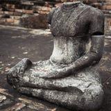 Ancient sandstone sculpture of Buddha. Ayutthaya, Thailand Royalty Free Stock Photo